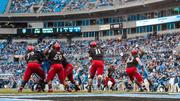 Cincinnati Bearcats quarterback Brendon Kay fires a pass from deep in his own territory. The North Carolina Tar Heels beat the Bearcats 39-17 in the 2013 Belk Bowl, played Dec. 28, 2013 at Bank of America Stadium in Charlotte.