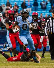 North Carolina Tar Heels freshman T.J. Logan breaks away from the pack on his way to a 78-yard kickoff return for a touchdown. The Tar Heels beat the Cincinnati Bearcats 39-17 in the 2013 Belk Bowl, played Dec. 28, 2013 at Bank of America Stadium in Charlotte.