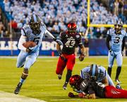 North Carolina Tar Heels wide receiver Sean Tapley steps out of bounds after a catch-and-run. The Tar Heels beat the Cincinnati Bearcats 39-17 in the 2013 Belk Bowl, played Dec. 28, 2013 at Bank of America Stadium in Charlotte.
