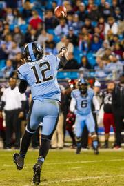 North Carolina Tar Heels quarterback Marquise Williams throws a quick out pattern to wide receiver Sean Tapley. The Tar Heels beat the Cincinnati Bearcats 39-17 in the 2013 Belk Bowl, played Dec. 28, 2013 at Bank of America Stadium in Charlotte.