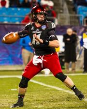 Cincinnati Bearcats quarterback Brendon Kay looks for an open receiver. The North Carolina Tar Heels beat the Bearcats 39-17 in the 2013 Belk Bowl, played Dec. 28, 2013 at Bank of America Stadium in Charlotte.