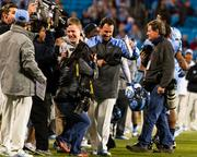 North Carolina Tar Heels head coach Larry Fedora laughs off a victory shower of Gatorade his players dumped on him seconds earlier. The Tar Heels beat the Bearcats 39-17 in the 2013 Belk Bowl, played Dec. 28, 2013 at Bank of America Stadium in Charlotte.