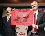 H.J. Heinz Co. Chairman and President William Johnson, left, and 3G Capital Managing Partner Alex Behring hoist a Heinz special edition of a Terrible Towel during a news conference Thursday, February 14, 2013, in which it was announced that Heinz has entered into a definitive merger agreement to be acquired by an investment consortium comprised of Berkshire Hathaway and 3G Capital. Read the initial story of the Heinz takeover  here.