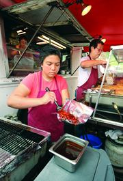 It's all hands on deck as Kathleen Narciso, her mother Sonia, and her uncle, Roberto Ching, prepare and serve up Asian cuisine from their Moonlight Express food truck in the Strip District.
