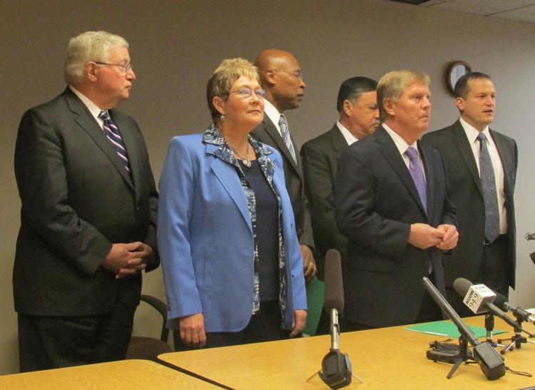 Everett Mayor Ray Stephanson, center, said only a yes vote by the Machinists will keep the Boeing 777X wing, and final assembly, in Everett. From left, Bob Drewel, former Snohomish County Executive; Kent Mayor Suzette Clark, Snohomish County Executive John Lovick, Renton Mayor Denis Law; Stephanson, and Troy McClelland, director of Economic Alliance Snohomish County.