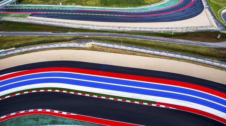 The brightly colored stripes which line the run-off area along a portion of The Circuit of The Americas is seen in this photograph. COTA claims that Travis County has overvalued the race track for a second year in a row, resulting in a $7 million property tax bill that its management claims is $5 million too high.