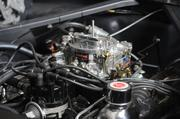 Under the hood of a restored 1965 Caspian blue Ford Mustang.