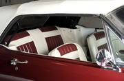 Interior view of 1965 red Ford Mustang.