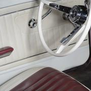 Interior detail of 1965 red Ford Mustang with white interior.