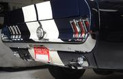 Rear view of 1967 blue and white Ford Mustang.