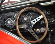 Behind the wheel of a 1968 '347' Ford Mustang convertible.