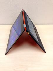 """The Lenovo Yoga 2 Pro, available in Clementine orange and silver, is named for its """"downward dog,"""" or """"tent mode"""" positioning. The super-high resolution qHD (quarter-high definition) and multi-touch display flips back to 360 degrees to allow the consumer to use the device as a laptop, tablet, stand or tent mode. The Yoga has up to nine hours of battery life, runs on Windows 8.1 and starts at $999.99."""