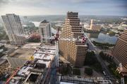 Standing atop a towering construction crane, Nick Simonite had a view not many people in Austin will ever have a chance to see while he produced images for our story on the massive cranes that dot our city.