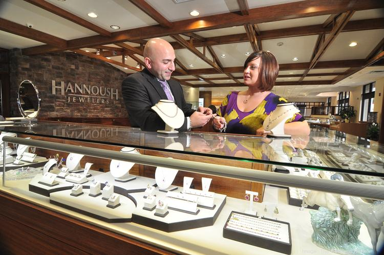 David Hannoush, co-owner of Hannoush Jewelers, with executive assistant Brittany Ellers at the family chain's Wolf Road location in Colonie, NY.