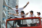 """Miami Heat player Chris """"Birdman"""" Andersen soars during a celebration parade after the team won the 2013 NBA Championships. See more photos of the celebration here: http://bizj.us/sm9ox"""