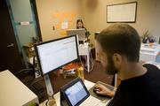 Co-working: Tech firm [Meta]marketer shares office space at CoLab Nashville.