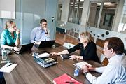 Accelerator: Joanna Rogerson and Jon Guida, left, of startup Gema Touch, discuss their business plan with HCA Holdings' Deb Reiner and Chip Blaufuss, mentors in the Healthbox accelerator program at the Nashville Entrepreneur Center.
