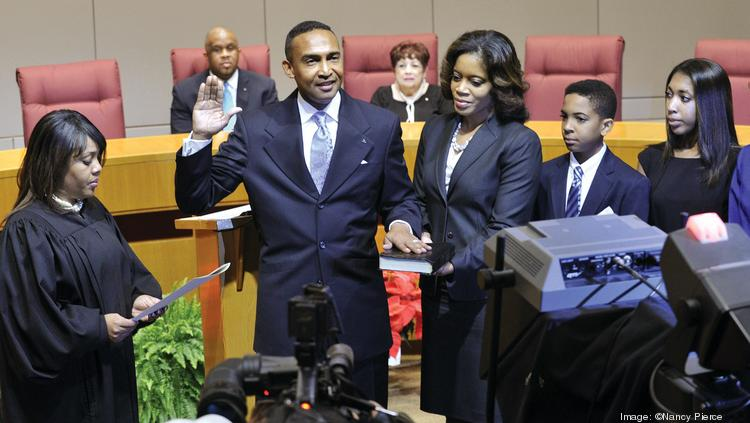 Patrick Cannon, with his wife, Trenna Cannon, at his side, took the oath of office as Charlotte's mayor on Dec. 2.