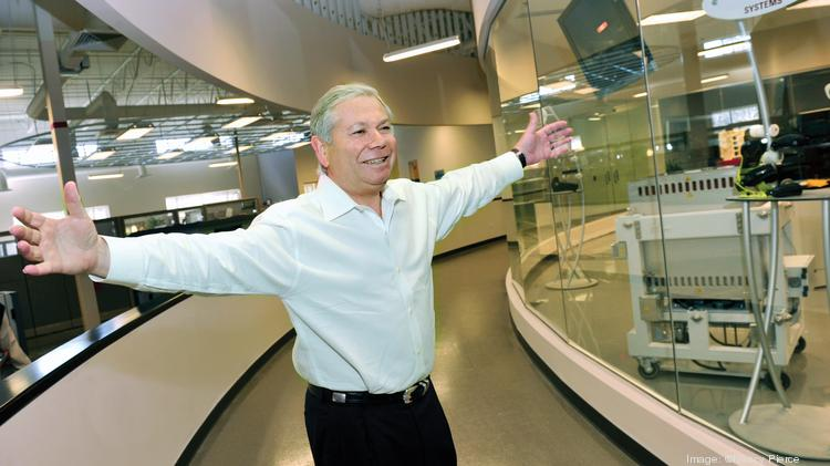 Avi Reichental, president and CEO of 3D Systems, at the company's Rock Hill plant. The rooms visible through the glass walls house rapid manufacturing and a printer demonstration center.