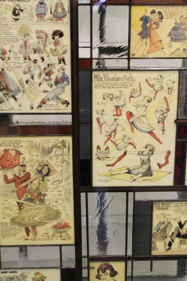 Old cartoons are set in glass in the first floor lobby.