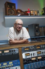 "Falk Audio owner Gary Falk is shown with an electronics console he built that is an ""effects processing rack"" for studio recordings."