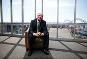 Jim Rickard of Community Bank Shares of Indiana sits in his Southern Indiana office overlooking the Sherman Minton Bridge.