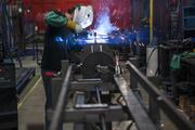 Aaron Elmore welds a stretch-wrapping machine at Lantech Inc.