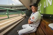 Jim Riggleman, manager of the Lousiville Bats, is shown in the team's dugout at Louisville Slugger Field.