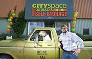 Christopher Conway Lavenson at Cityspace on Main with his Labradoodle Wahoo and a 1974 Ford F-100 with 48,000 original miles that he restored.