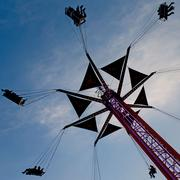 Fairgoers soar above the fairgrounds as the sunsets on the Maryland State Fair in Timonium.