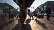 As the sun rises, two women walk their dogs down Main Street in Annapolis.