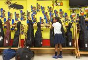 Students put away their instruments after an afternoon in the ORCHkids program at Lockerman-Bundy Elementary School.