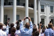 As camera phones grow ever popular, the challenges continues to increase for photojournalists. As President Barack Obama and the Baltimore Ravens filed out of the White House for a ceremony honoring the Super Bowl champions, guests at the ceremony immediately stood with their camera phones, effectively blocking the view of the media behind them.
