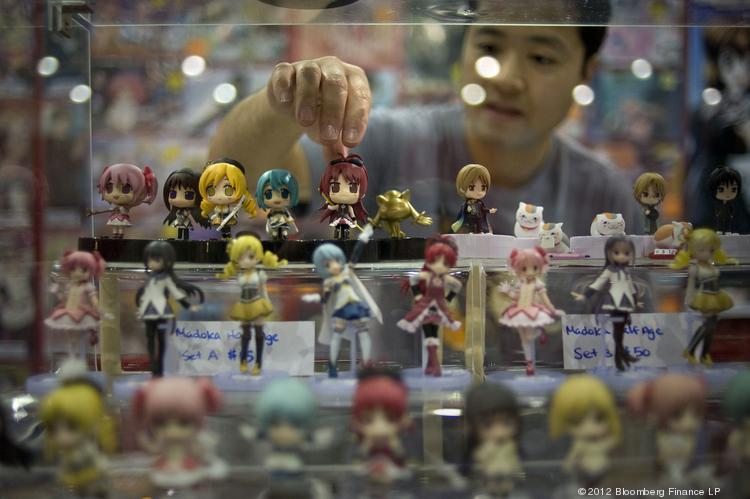 A man reaches for a miniature anime character at an anime expo in Los Angeles in 2012. Sacramento is again the site of an anime convention, dubbed SacAnime.
