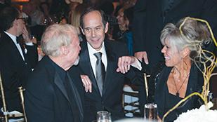 Nike Inc. Chairman Phil Knight (left) and wife, Penny, (right) chat with Dr. Brian Druker, director of Oregon Health & Science University's Knight Cancer Institute, at the September gala at which the Knights pledged $500 million to cancer research. OHSU has two years to raise matching funds.