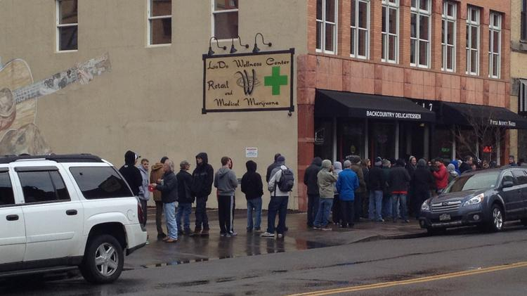 Hundreds waited in line for up to two hours Wednesday for the first legal, non-medical marijuana sales at LoDo Wellness Center, 1617 Wazee St.