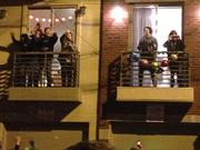 Residents dance to the music from their balconies.