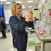 UHS nurse readies medication for a patient; the Emergency Center at University Hospital is the busiest in the region and averages nearly 70,000 visits each year.