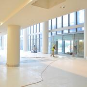 Construction workers are putting the final touches on the new entrance of the 10-story UHS ER tower in the South Texas Medical Center, scheduled to open in early 2014. The lobby will feature a Starbucks and a food marketplace, which will emphasize healthy foods.