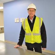 Brian D. Fruge, senior project manager with   Broaddus Muñoz, a joint venture project manager of the hospital. The new tower will feel less antiseptic, featuring warm paint colors and modern amenities. All told, the tower will house an expanded emergency center with 84 beds, two floors of surgical suites, 420 private inpatient rooms.