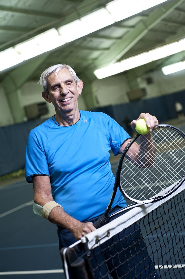 George Chapman, managing director for Integra Realty Resources Inc., spends a lot of time every week staying in shape by playing tennis at Advantage Tennis + Tennis in Dupont.