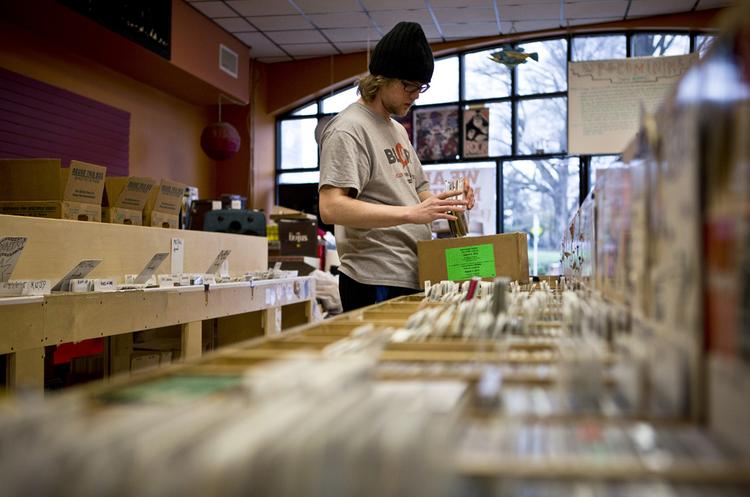 Kyle Rosko, an employee at Schoolkids Records on Hillsborough Street in Raleigh, helps pack CDs into boxes for the store's move to a new location at the Mission Valley Shopping Center on Thursday, Jan 2. Schoolkids Records has been at the Hillsborough location for the past four years, but is moving to make way for a new boutique hotel.