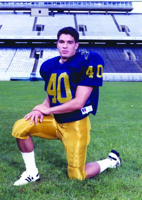 Scott Wine played football in high school and at the Naval Academy.