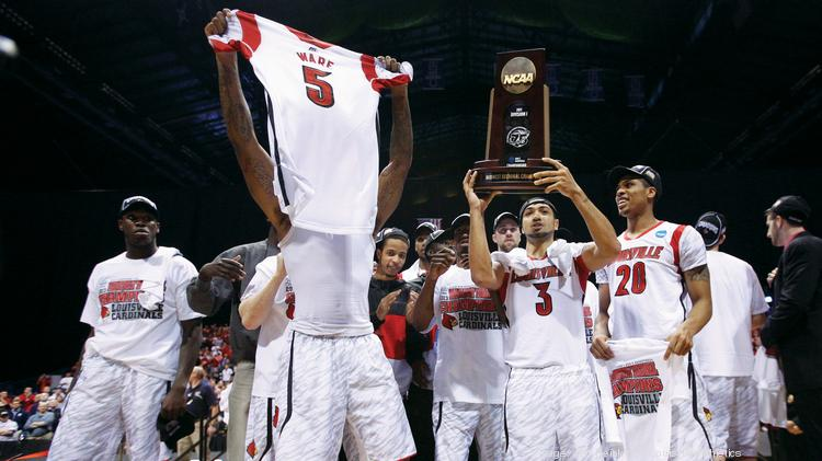 Members of the U of L men's basketball team celebrate after a victory over Duke in the Midwest regional final in 2013.