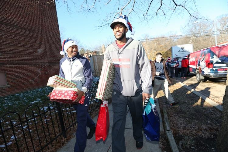 Washington Wizards guard John Wall, left, and forward Trevor Booker made surprise deliveries for a needy D.C. family