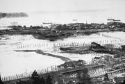 What people now know as the Seattle waterfront was a flood-prone tide flat when this photo was taken in 1895. The seawall that helped reclaim the area is being replaced with one to better withstand earthquakes and erosion.