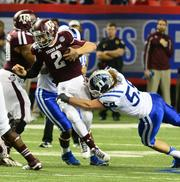 The Chick-fil-A Bowl on New Year's Eve at the Georgia Dome in Atlanta matched Duke University vs. Texas A&M, with Texas A&M winning 52-48.