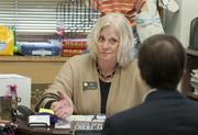 Sen. Cheri Jahn talks with a staff member in her office at the Capitol.