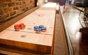 A shuffleboard table and board games can be checked out at tables.