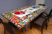 The conference room table in the offices of Squid Ink Creative and Computer Training Systems is made out of Lego bricks.